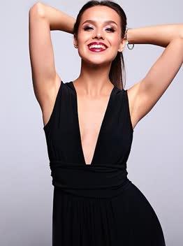 Black dress with a deep neckline size. S - XXL